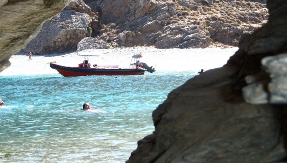 swimming in remote beaches of Karystos